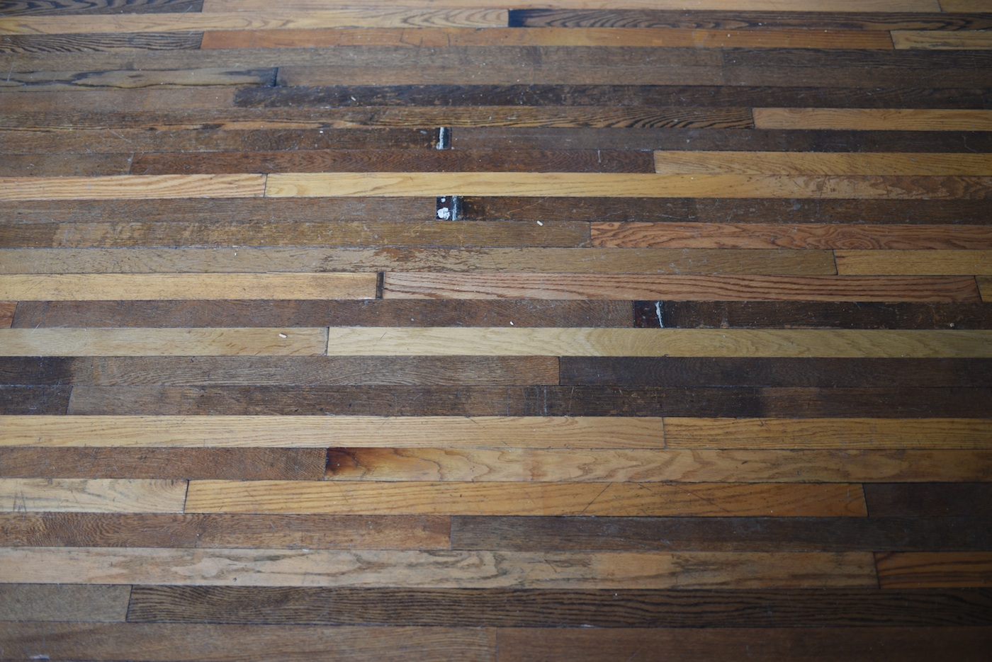 This Remington rowhouse-turned-gallery used our oak blend flooring for  their space - Reclaimed Oak Blend Flooring - Brick + Board